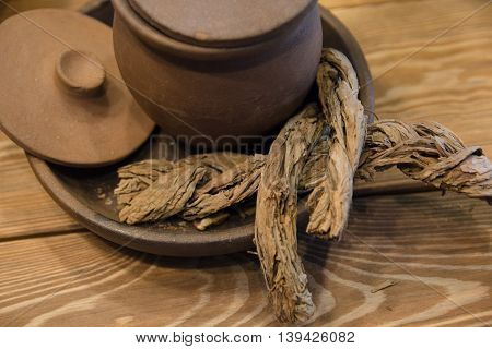 bark in a clay pot with lid