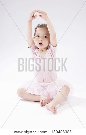 Children Concepts and Ideas. Portrait of Little Cute Caucasian Girl Posing Against White Background. Vertical Image