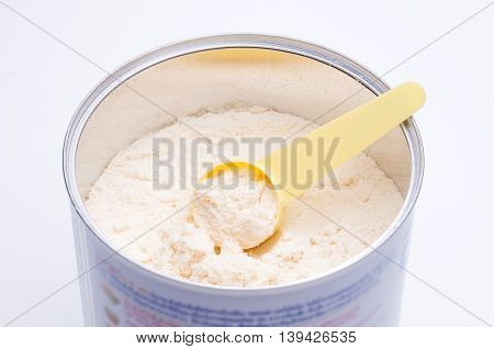 Baby milk powder in cans that open with a spoon.