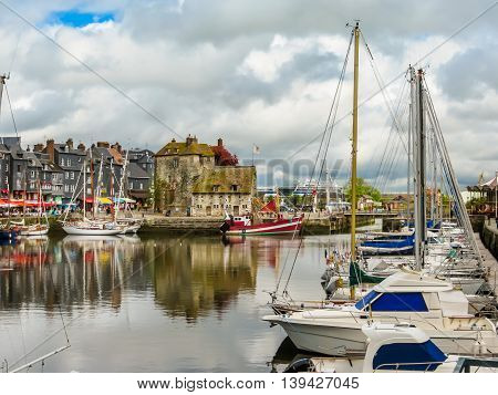 The moored yachts and medieval houses in Old port. Honfleur, Normandy, France