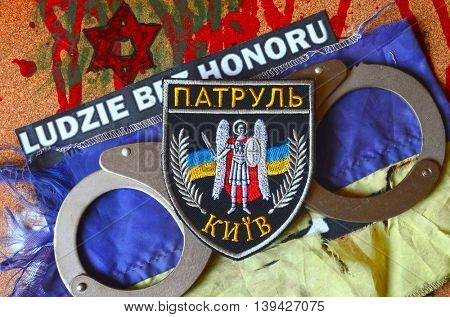 ILLUSTRATIVE EDITORIAL.Chevron of Ukrainian police.Background - Polish anti-ukrainian poster.Civil War in Ukraine.July 13 ,2016 in Kiev, Ukraine