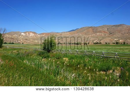 Foothills provide a background for a ranch near Salmon, Idaho.