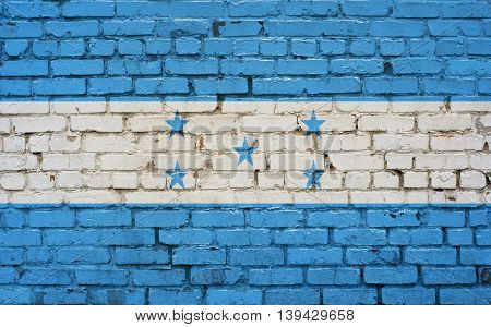 Flag of Honduras painted on brick wall background texture