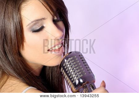 Girl singing in retro mic