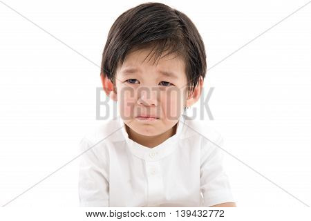 Close up of cute asian child crying on white background isolated
