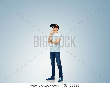 3d technology, virtual reality, entertainment, cyberspace and people concept - happy young man with virtual reality headset or 3d glasses thinking and looking at something