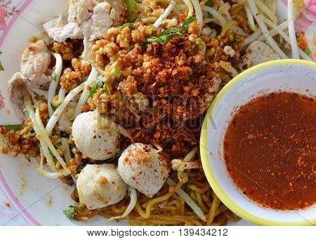 cayenne pepper and roasted bean on egg noodle with pork ball
