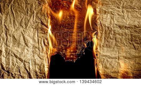 Burning old paper on black backgrounb.