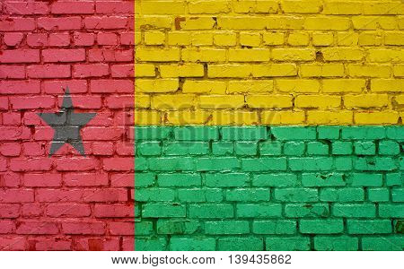 Flag of Guinea Bissau painted on brick wall background texture