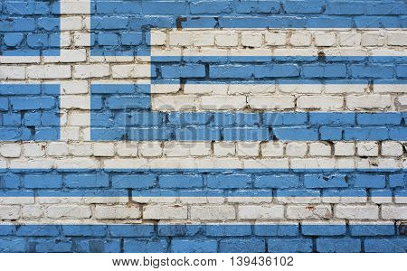 Flag of Greece painted on brick wall background texture