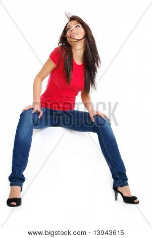 sexy girl in jeans sitting on the white table