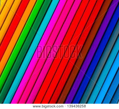 Line of colored pencils. Background of colored pencils for creativity
