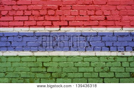 Flag of Gambia painted on brick wall background texture