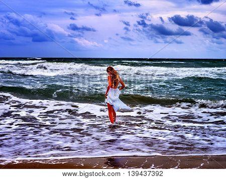 Summer girl sea. Beautiful girl walk at water on sea beach.