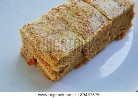 coffee cake dairy product on the white dish