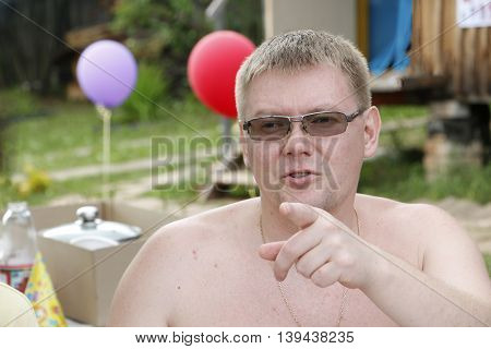 Brutal Man At A Picnic In A Summer Day