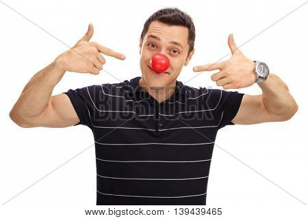 Cheerful man pointing at his red clown nose isolated on white background