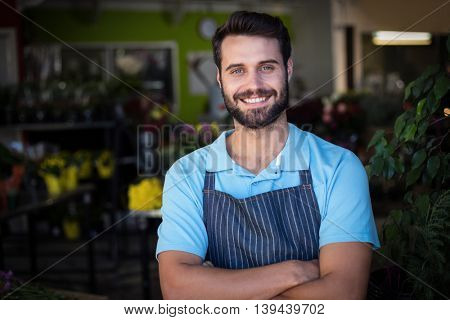 Portrait of male florist smiling in the flower shop