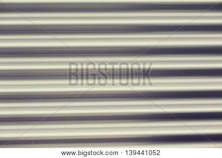 background and texture - close up of aluminum metal garage door backdrop