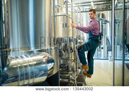 Portrait of confidence maintenance worker at brewery
