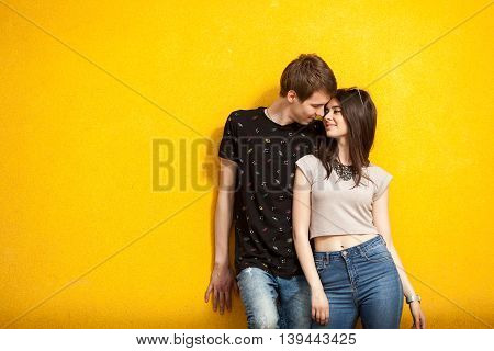 Young Inlove Couple On Yellow Wall