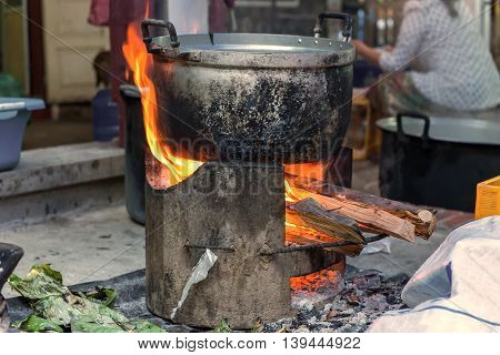 Traditional Of Making Food With Pots On The Stove Over A Natural Fire For Cooking