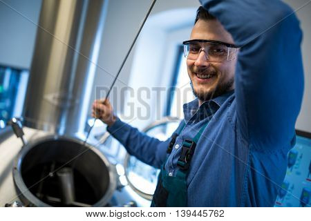 Portrait of happy brewer working at brewery