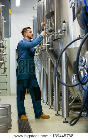 Attentive maintained worker working at brewery