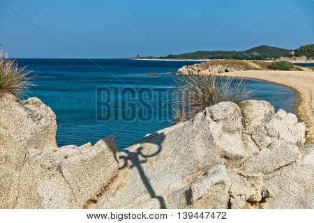 Sea rocks at sandy beach, early morning at west coast of peninsula Sithonia, Chalkidiki, Greece