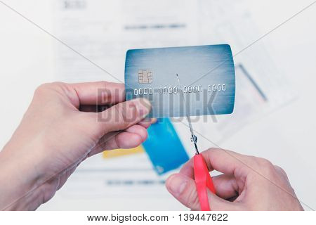 Hands Cutting A Credit Card With Scissors,woman Is Cutting Credit Card Or Bank Card With Scissors Ov