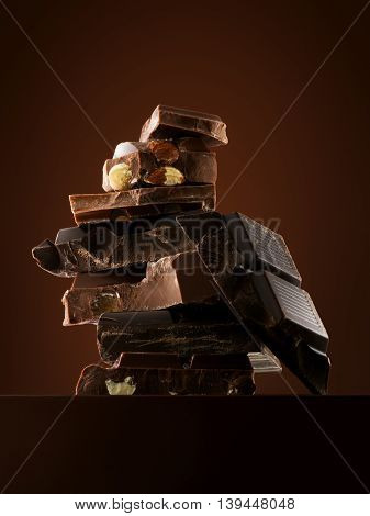 Close up view of chocolate bars on brown background