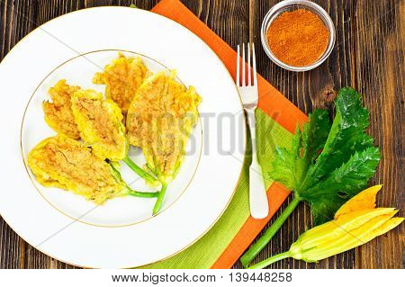 Flowers of Zucchini, Fried in Batter on a Wooden Background Studio Photo
