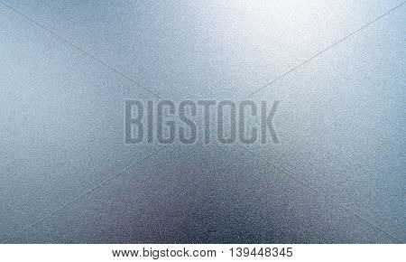 Grey shiny metal surface with a texture in the form of small pimple