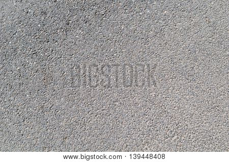 Plastered concrete surface with uneven rough texture