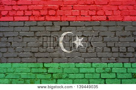 Flag of Libya painted on brick wall background texture