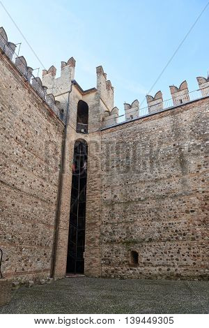 Sirmione Italy - February 21 2016: The Scaliger Castle is a medieval port fortification located at the entrance to the sirmio peninsula which divides the lower part of Lake Garda.