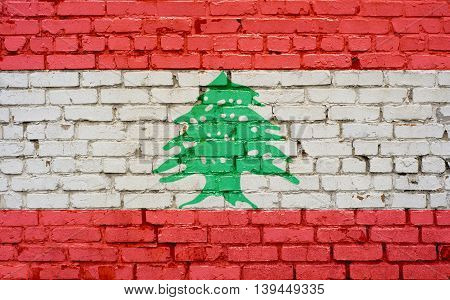 Flag of Lebanon painted on brick wall background texture