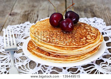 Tasty Pancakes Stack with Honey and Cherry Studio Photo