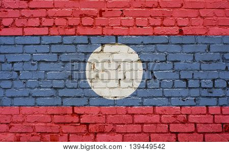 Flag of Laos painted on brick wall background texture