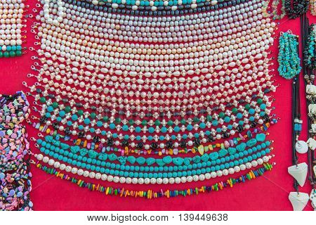 Hand Made Of Colorful Necklaces And Bracelets From Coral Or Bead In A Local Market