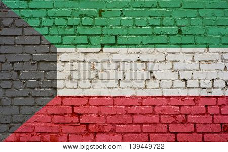 Flag of Kuwait painted on brick wall background texture