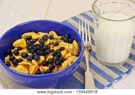 Cornflakes with Bilberry and Chocolate. Healthy Breakfast Studio Photo