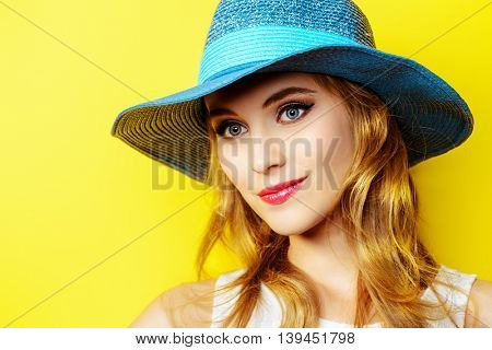 Portrait of a beautiful girl with a happy smile over yellow sunny background. Summer holidays. Happiness.