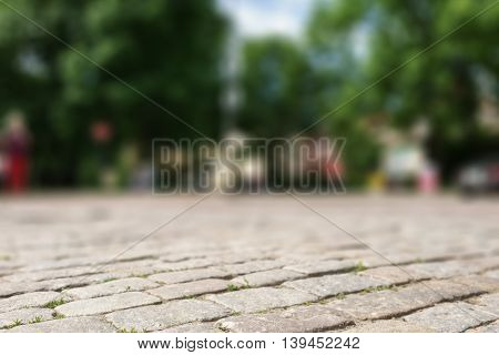 perspective view of old paved square in town, background