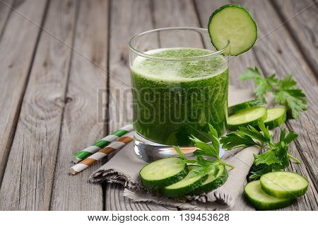 Healthy green smoothie with cucumber and parsley, selective focus, copy space