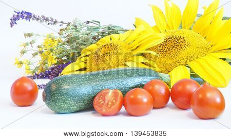 Still Life of Vegetables and a bouquet of flowers