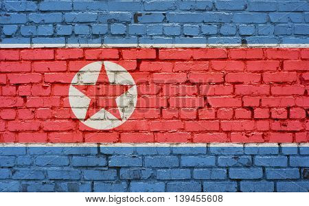 Flag of North Korea painted on brick wall background texture