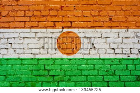 Flag of Niger painted on brick wall background texture