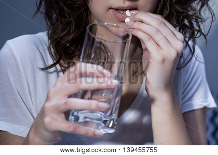 Woman Taking A Pill
