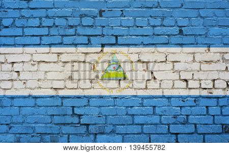 Flag of Nicaragua painted on brick wall background texture